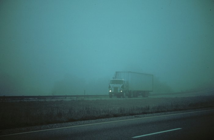 truck driving through fog