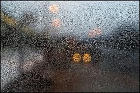 freezing drizzle on a bus shelter window