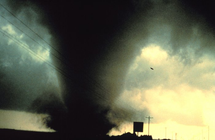 a tornado forms within a severe thunderstorm (NOAA)